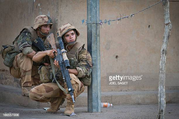 French soldiers take position during a false alert by the population signaling the presence of MUJAO members in a street in Gao on April 13 2013 Gao...