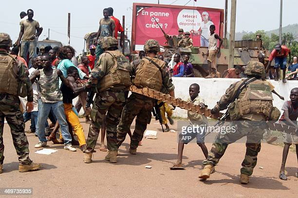 French soldiers taking part in 'Operation Sangaris' clash with Christians from the PK 12 neighbourhood of Bangui who created a barricade to block the...