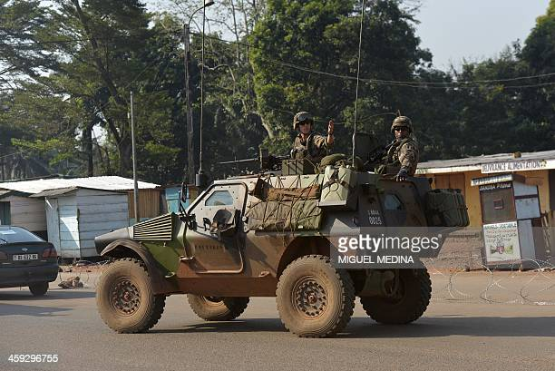 French soldiers taking part in the operation Sangaris patrol in armoured vehicles in the PK 12 district in Bangui on December 25 2013 Chadian troops...