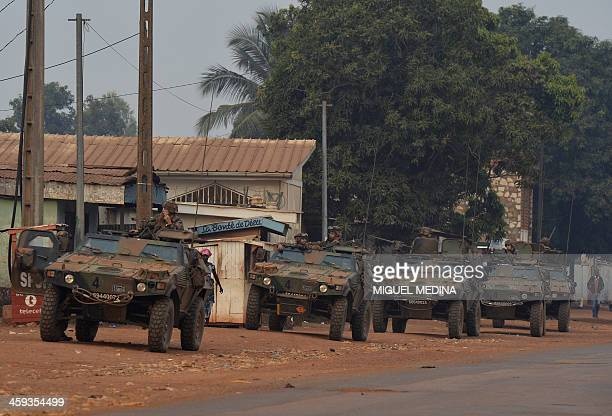 French soldiers taking part in the Sangaris operation patrol in the Banga district in Bangui on December 26 2013 Heavy arms fire triggered panic on...