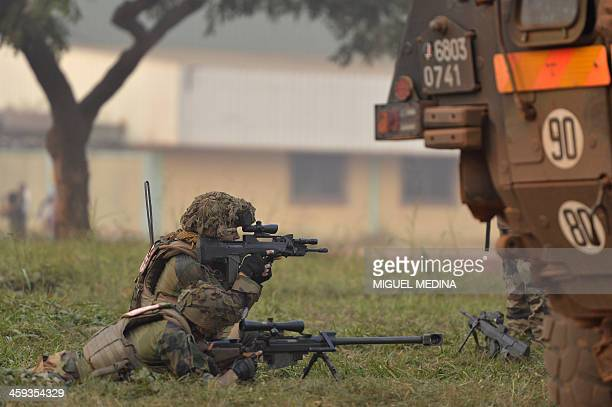 French soldiers taking part in the Sangaris operation protect the Combattant district close to the airport in Bangui on December 25 2013 Heavy arms...
