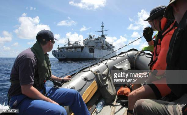 French soldiers train on a rubber boat next to French warship Nivose on April 28 two days after leaving the Mombasa harbour in Kenya The ship is in...