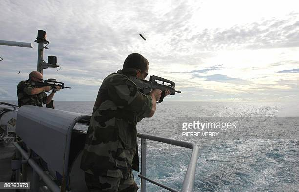 French soldiers train on the deck of the French warship 'Nivose' during a training on April 28 two days after leaving the Mombasa harbour in Kenya...