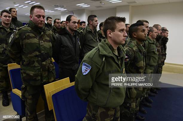 French soldiers wait for the arrival of French and Spanish defence ministers at Los Llanos military base in Albacete on January 27 2015 a day after a...