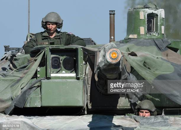 French soldiers wait with their tank type 'Leclerc' during a break of the exercise 'Strong Europe Tank Challenge 2017' at the exercise area in...