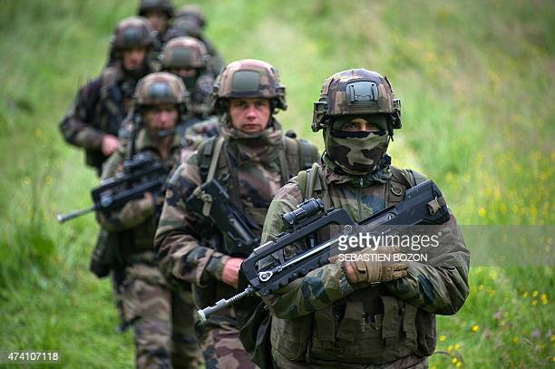 French soldiers walk in a line during a FrenchUS Royal Blackhawk military exercise with French US Dutch British and Belgian troops on May 20 in...