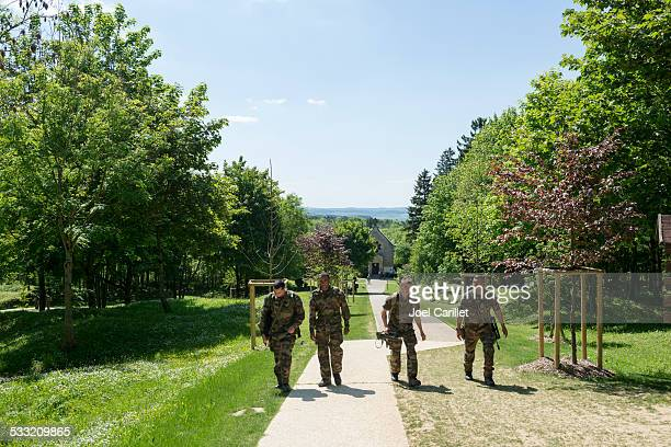 french soldiers walk in fleury-devant-douaumont - french army stock pictures, royalty-free photos & images