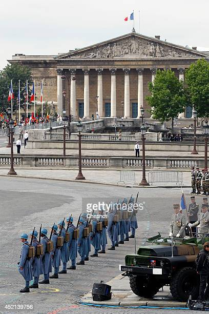 French soldiers wear WWI French soldiers 'Poilu' uniforms during the annual Bastille Day military parade on the Place de la Concorde in Paris on July...