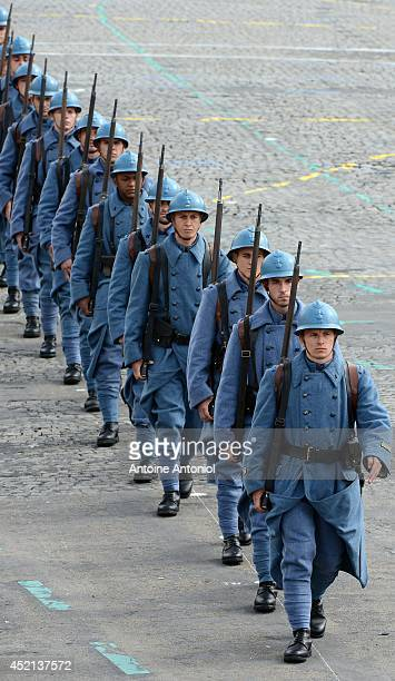 French soldiers wearing WWI French soldiers 'Poilu' uniforms parade on the ChampsElysees during the annual Bastille Day military parade on July 14...