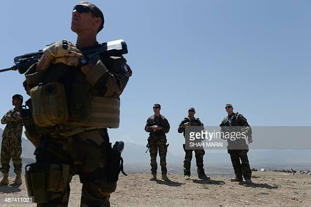 French soldiers with NATOled International Security Assistance Force watch Afghan National Army helicopters during a military exercise on the...