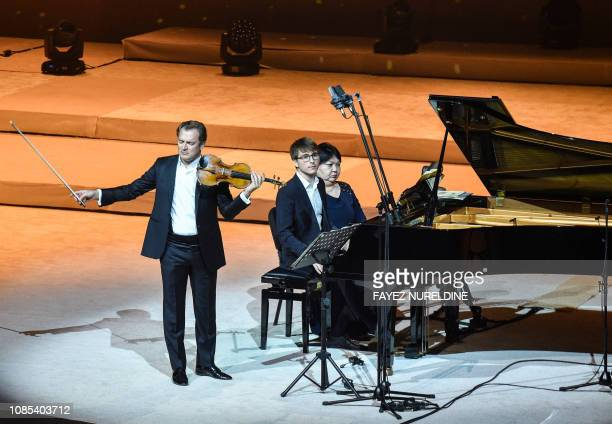 French solo violinist Renaud Capucon salutes the audience during the first 'Winter at Tantora' music carnival at the purposebuilt Maraya concert hall...