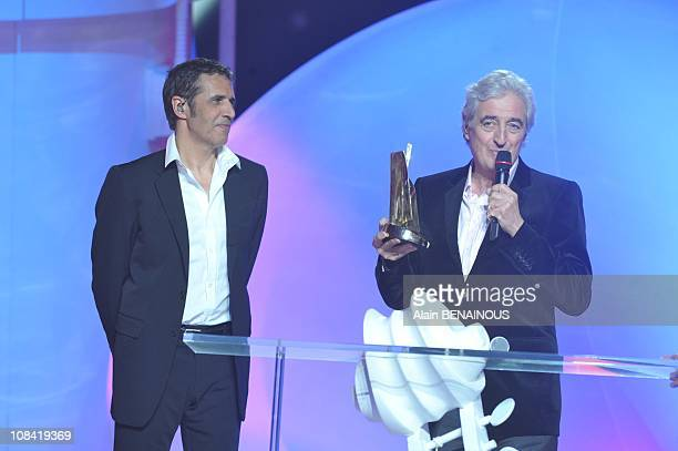 French song writer JeanLoup Dabadie delivers a speech after receiving an honorary award from French singer Julien Clerc in Paris France on February...