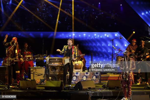 French songwrite singer musician and composer Matthieu Chedid aka M and Malian musician and singer Sidiki Diabate perform on stage during the 33rd...