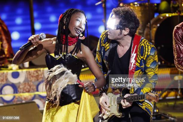 French songwrite singer musician and composer Matthieu Chedid aka M and Malian singer Fatoumata Diawara perform on stage during the 33rd Victoires de...