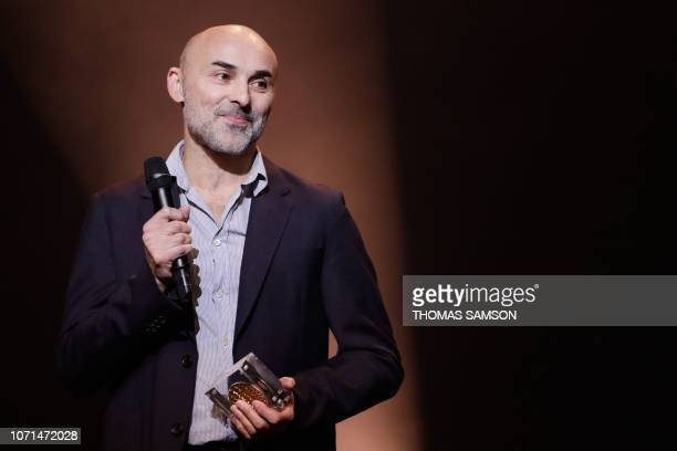 French songwriter and composer PierreDominique Burgaud celebrates after receiving the 'Best French music author and composer' award Grand prix de la...