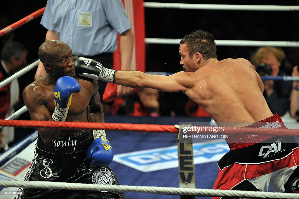 French Souleymane Mbaye (L) fights with Antonin Decarie of Canada during their WBA World Championship Welterweight match at the Marcel Cerdan hall in Levallois, near Paris, on May 28, 2010. Mbaye defeated Decarie.