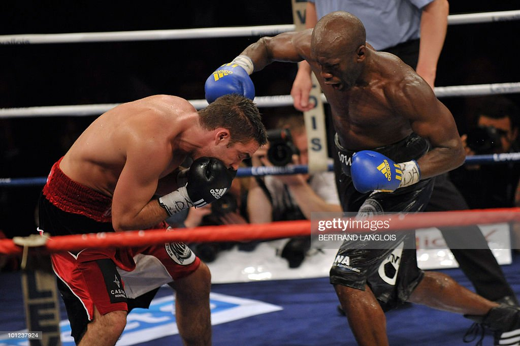 French Souleymane Mbaye (R) fights with Canadian Antonin Decarie during their WBA World Championship Welterweight match at the Marcel Cerdan hall in Levallois, near Paris, on May 28, 2010. Mbaye defeated Decarie.