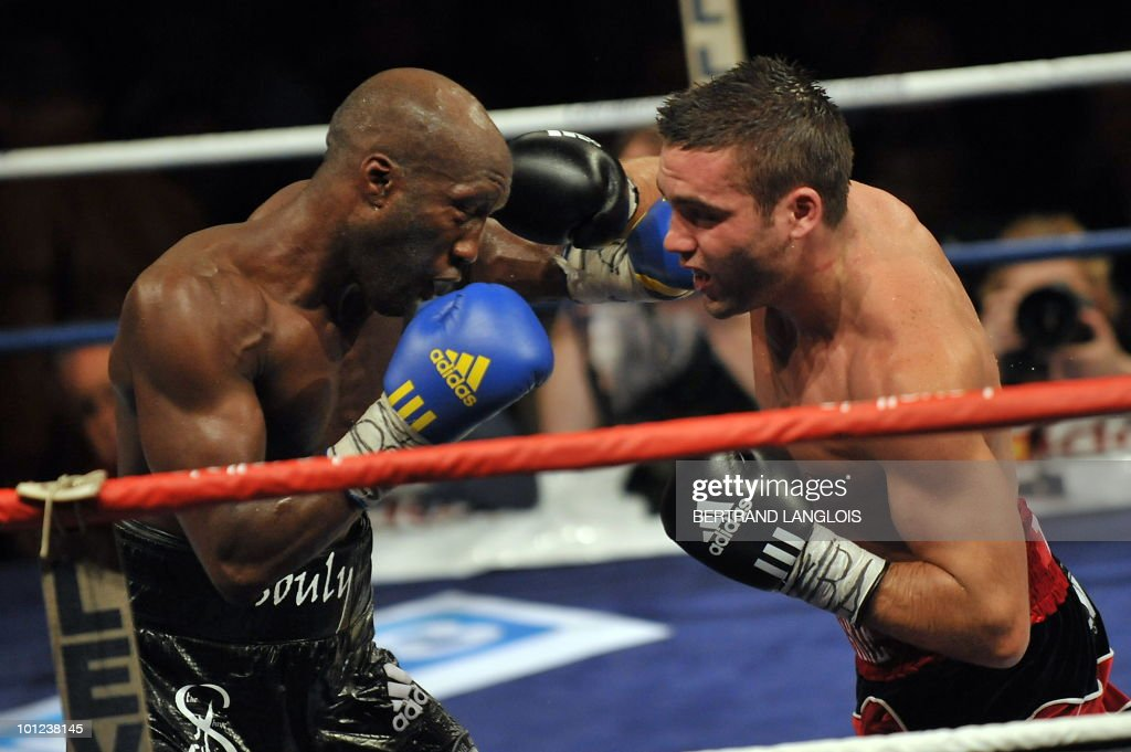 French Souleymane Mbaye (L) fights with Canadian Antonin Decarie during their WBA World Championship Welterweight match at the Marcel Cerdan hall in Levallois, near Paris, on May 28, 2010. Mbaye defeated Decarie.