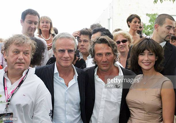 French speaking Cinema festival president Dominique Besnehard poses flanked by French actors Christophe Lambert and Sophie Marceau and French...