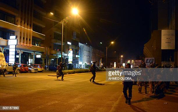 French special forces and a Burkina Faso's soldier take position in the surroundings of the hotel Splendide and the cafe Cappuccino during an attack...