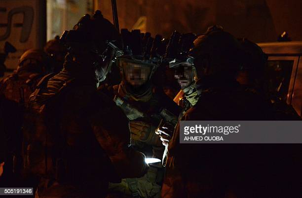 French special forces gather while taking position in the surroundings of the Splendid hotel and a restaurant during an attack on both the hotel and...