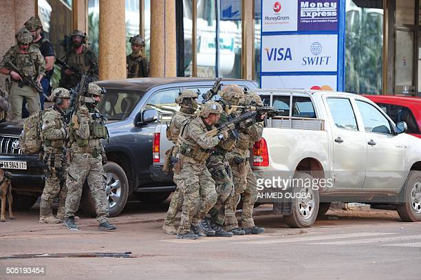 French special forces take position in the surroundings of the Splendid hotel following an attack by AlQaeda linked gunmen on January 16 2016 in...