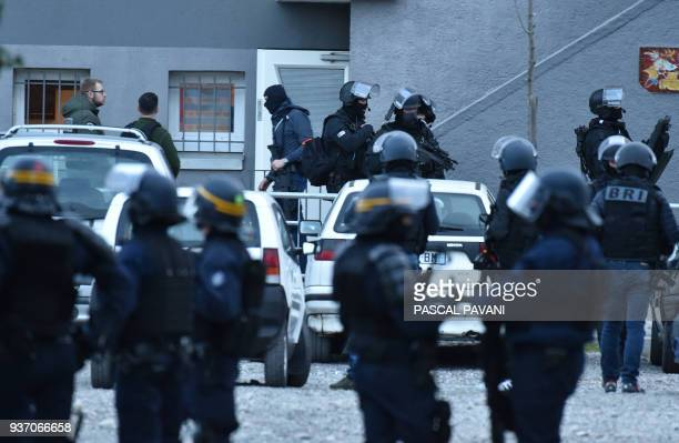 TOPSHOT French special police forces arrive to perform a search operation at the Ozanam housing estate in Carcassonne southwestern France on March 23...