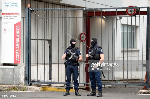 French special police officers stand guard at the entrance of the Georges Pompidou Hospital in Paris on August 11 where the suspect in the attack of...
