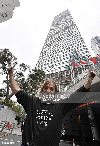 French SpiderMan Alain Robert celebrates after scaling one of Hong Kong's tallest skyscrapers the Cheung Kong Centre on February 17 2009 in what he...
