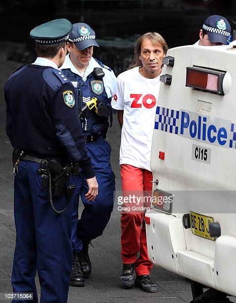 'French Spiderman' Alain Robert is arrested by police after climbing the 57storey Lumiere building on August 30 2010 in Sydney Australia Robert who...