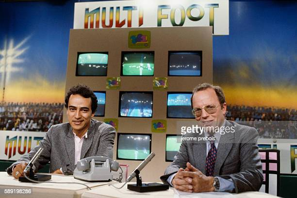 French sports journalists Didier Roustan and Thierry Roland on the set of program Multi foot on TF1