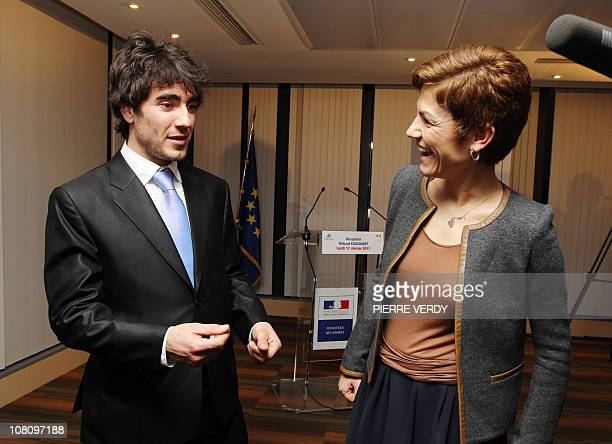 French Sports minister Chantal Jouanno chats with European short track speed skating champion French Thibaut Fauconnet during a ceremony on January...