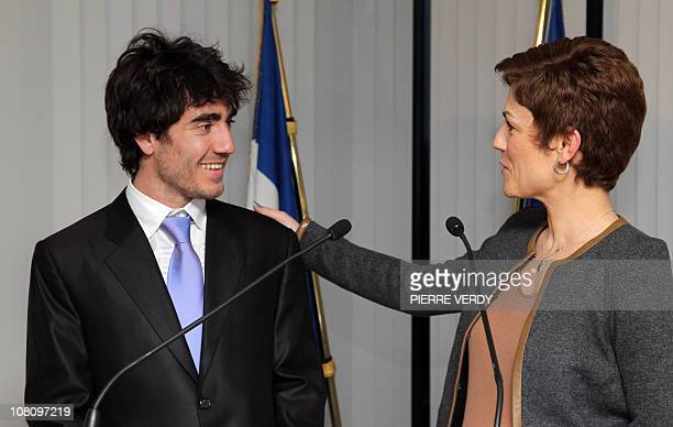 French Sports minister Chantal Jouanno congratulates European short track speed skating champion French Thibaut Fauconnet during a ceremony on...