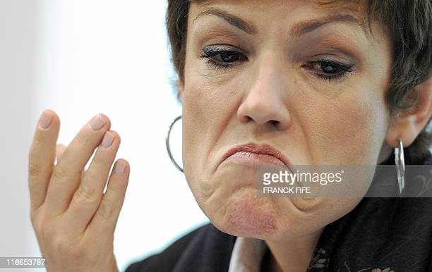 French Sports minister Chantal Jouanno gives a press conference on May 11 2011 at the Insep headquarters in Paris after a joint hearing of the French...