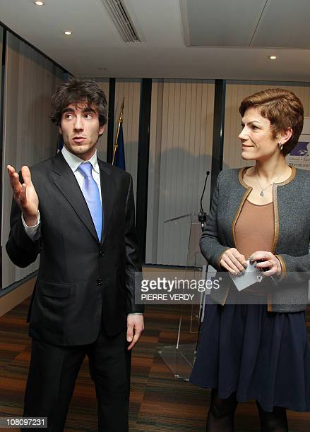 French Sports minister Chantal Jouanno listens to European short track speed skating champion French Thibaut Fauconnet during a ceremony on January...