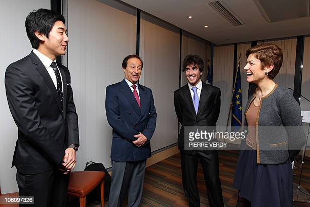 French Sports minister Chantal Jouanno speaks with SouthKoreean coach Cho HangMin coach of the French Ice sports Federation as she welcomes European...