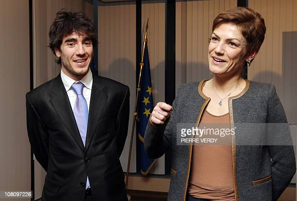 French Sports minister Chantal Jouanno welcomes European short track speed skating champion French Thibaut Fauconnet during a ceremony on January 17...