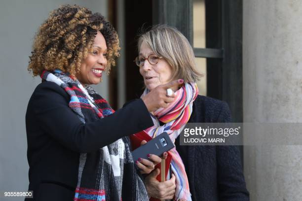 French Sports Minister Laura Flessel and French Culture Minister Francoise Nyssen talk as they leave after the weekly Cabinet meeting on March 21...