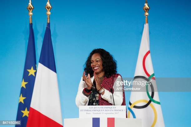 French Sports Minister Laura Flessel applauds after speaking during a ceremony at the Elysee Palace in Paris on September 15 2017 to celebrate Paris'...