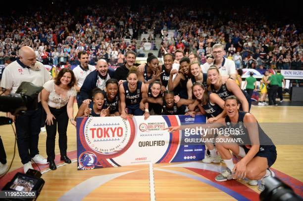French Sports Minister Roxana Maracineanu and France players celebrate their win against Brazil in the FIBA Women's Olympic Qualifying Tournament...