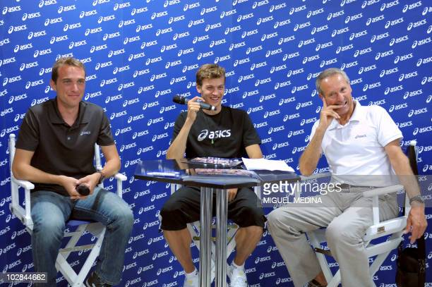 French sprinter Christophe Lemaitre flanked by his coach Pierre Carraz and athletic equipment company Asics France promo manager Olivier Mignon takes...