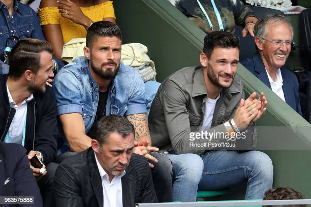 French squad soccer player Olivier Giroud and Hugo Lloris attend the 2018 French Open Day Three at Roland Garros on May 29 2018 in Paris France
