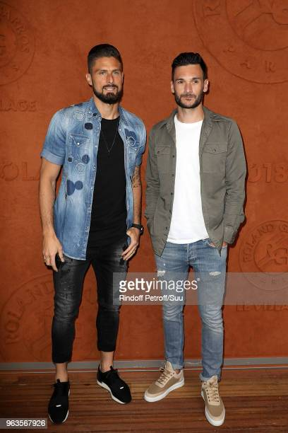 French squad soccer players Olivier Giroud and Hugo Lloris attend the 2018 French Open Day Three at Roland Garros on May 29 2018 in Paris France