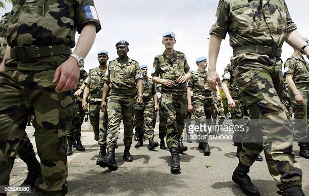 French squadron arrives 06 May 2004 at Abidjan military airport to reinforce a UN peacekeeping operation deployed to steer the west African state...