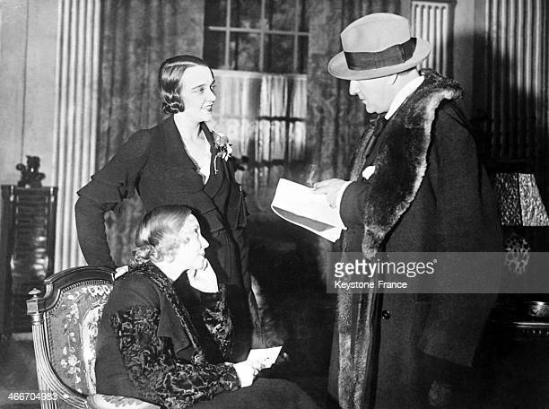 French stage actor Sacha Guitry during rehearsal of his play at a London hotel with actresses Madeleine Renaud seated and Jacqueline Delubac on...