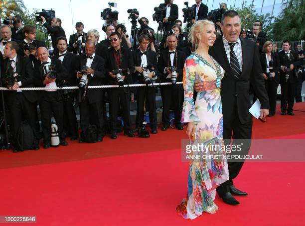 French stand-up comedian Jean-Marie Bigard poses 19 May 2007 with his wife Claudia upon arriving at the Festival Palace in Cannes, southern France,...