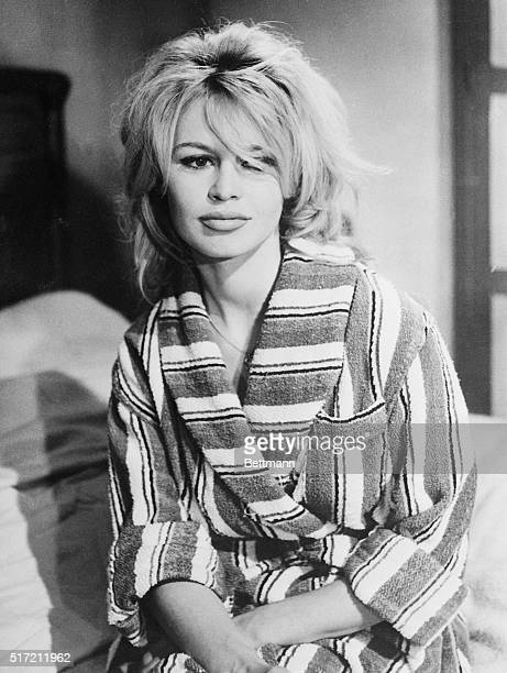 French star Brigitte Bardot who apparently has lost little time getting down to business since the birth of her son early in the year is shown during...