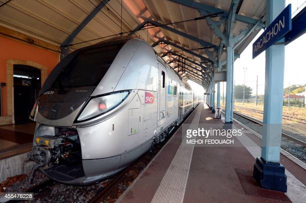 A French Stateowned rail operator SNCF new TER Regio 2N train is pictured on September 15 2014 at Arcachon train station Southwestern France This new...