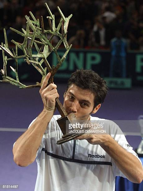 French STbastien Grosjean kisses his first place trophy after winning the final game against his Russian opponent Yevgeny Kafelnikov on the seventh...