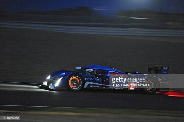 French Stephane Sarrazin steers his Peugeot 908 HdiFAP N°2 on June 9 2010 in Le Mans western France during the first free practice session of the Le...
